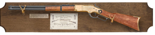 1866 Winchester replica rifle in framed display.