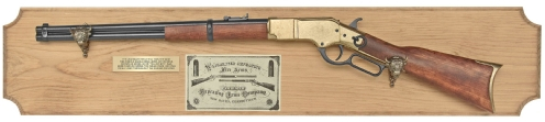 1866 Lever Action Rifle on stained wood plaque, mounted with antiqued brass buffalo head hangers, brass identification plate and vintage product label.