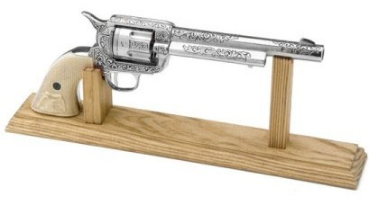 Wood display stand for pistols & revolvers.