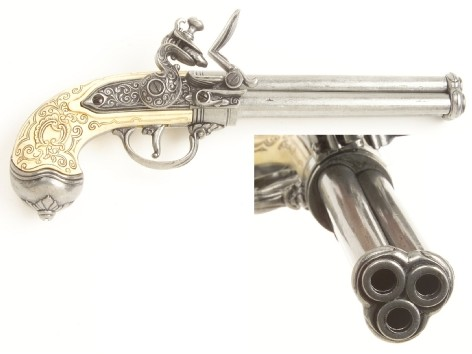 Italian triple-barrel flintlock in antiqued silvertone finish with simulated ivory grip.