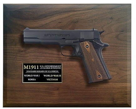 Framed display of M1911 US military pistol.