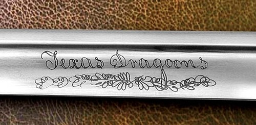 Detail  of Texas Dragoons engraving on the blade of a replica Texas Dragoon saber replica