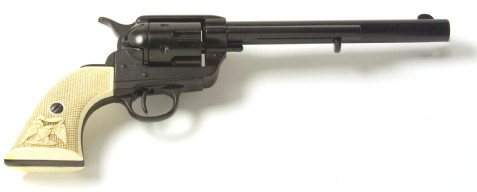 1873 SAA ,45 Cavalry style revolver replica, black with simulated ivory grips, 7.5 inch barrel.