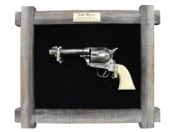 John Wayne .45 six-shooter in barnwood framed display